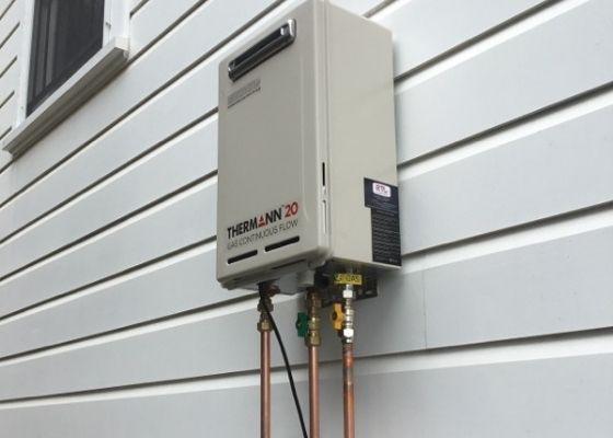 Thermann Gas Hot Water Unit Installed on the side of a Queenslander Home