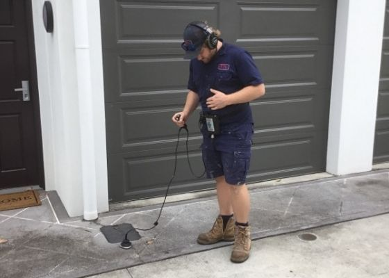 RTL Plumber using leak detection equipment