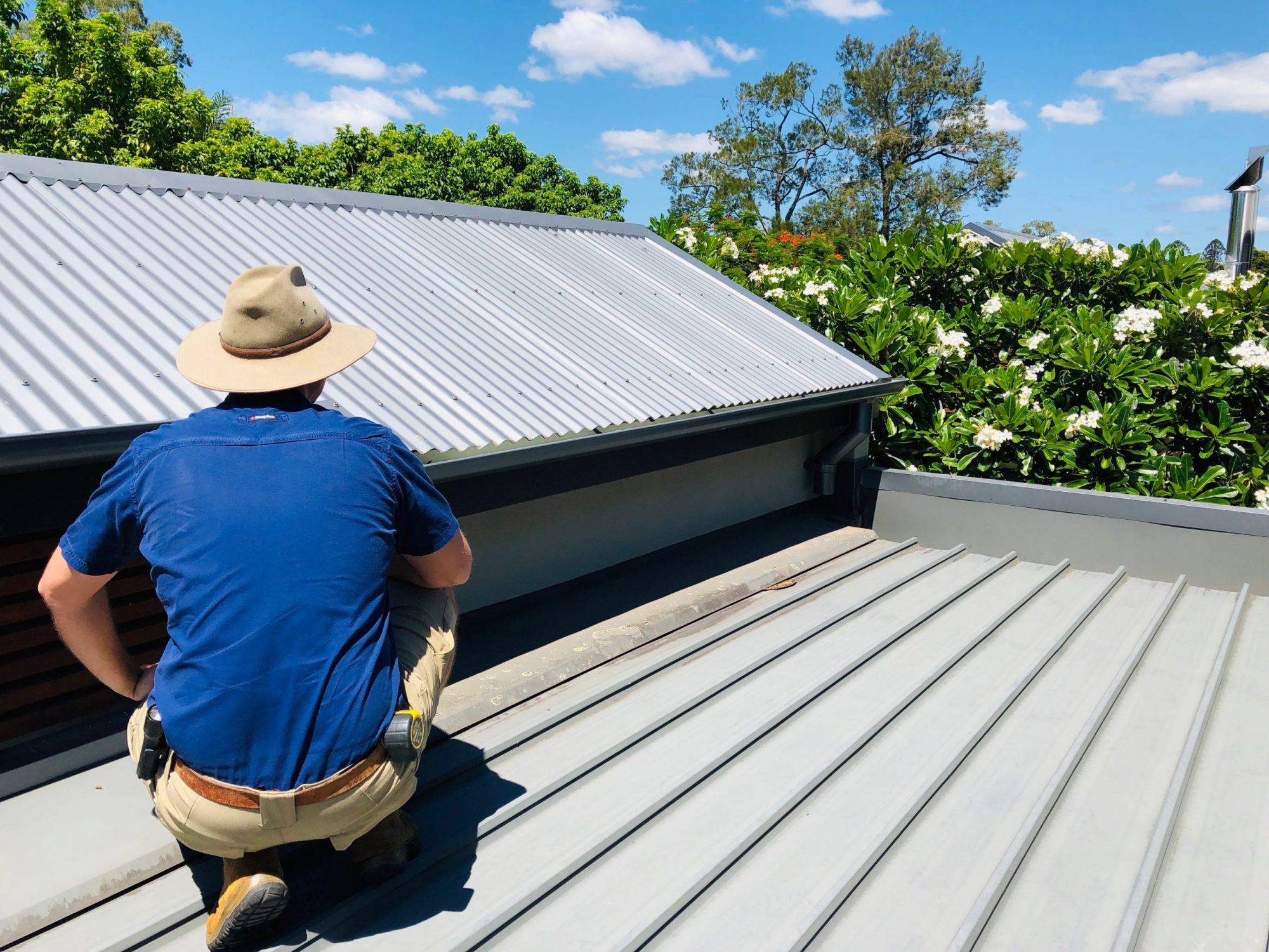 OneHome Building Inspector Inspecting a Metal roof