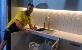 handyman installing commercial fitout in Brisbane CBD offices