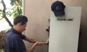 plumber repairing hot water system for home in Brisbane