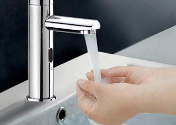young family washing hands using movement sensing taps inside Bulimba bathroom