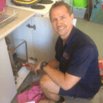 Morningside electrician inspecting power box before fixing electrical issues inside home