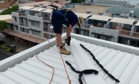 local roofer fixing roof damaged by hailstorm