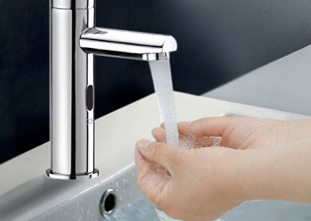 woman using motion sensor taps to wash hands without touching the tap