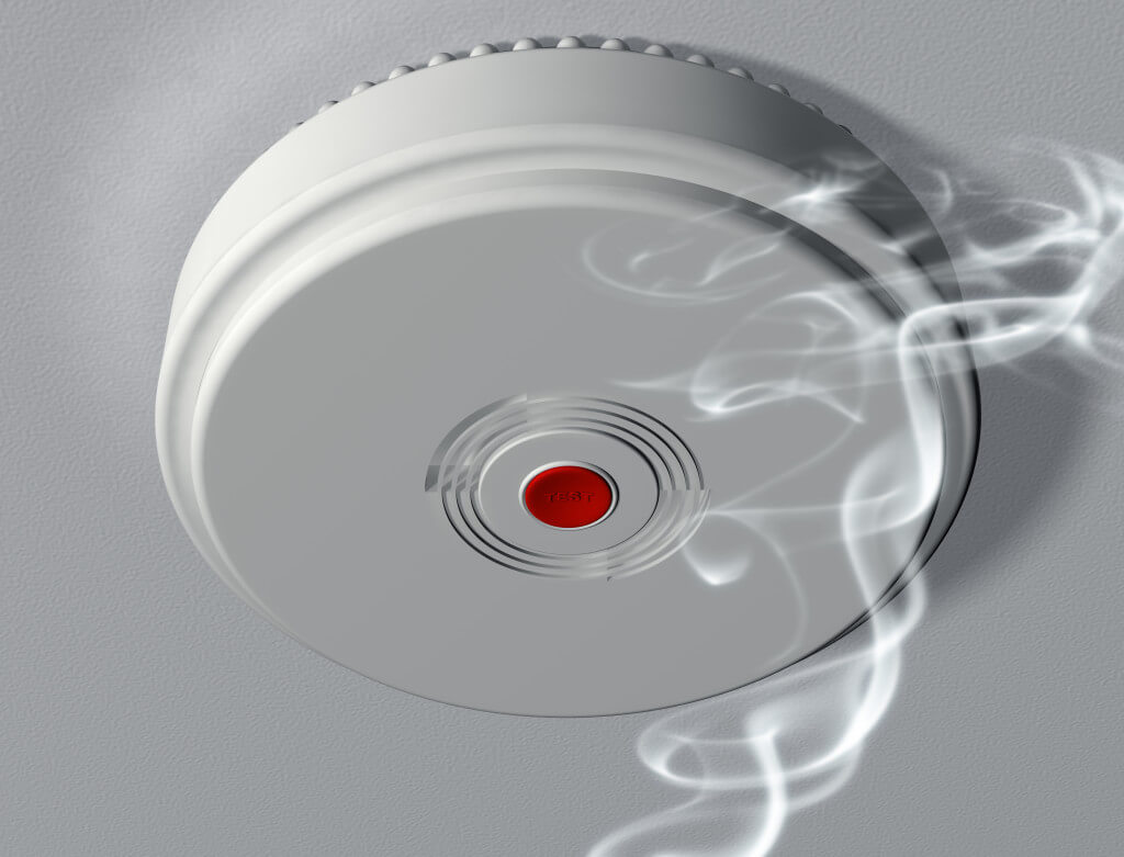 licensed Electricians installing smoke alarms in new house