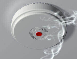 smoke alarm system being installed by electrician in Hawthorne