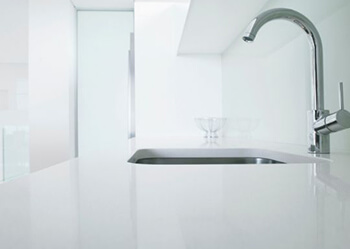 team of specialist plumbers installing plumbing into Bulimba home kitchen