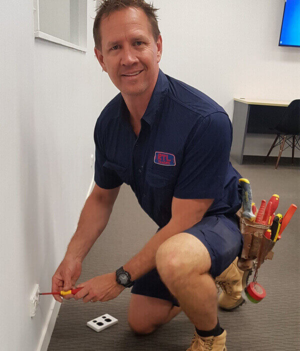 Electrician testing and tagging wires for new home being renovated in Hawthorne, QLD