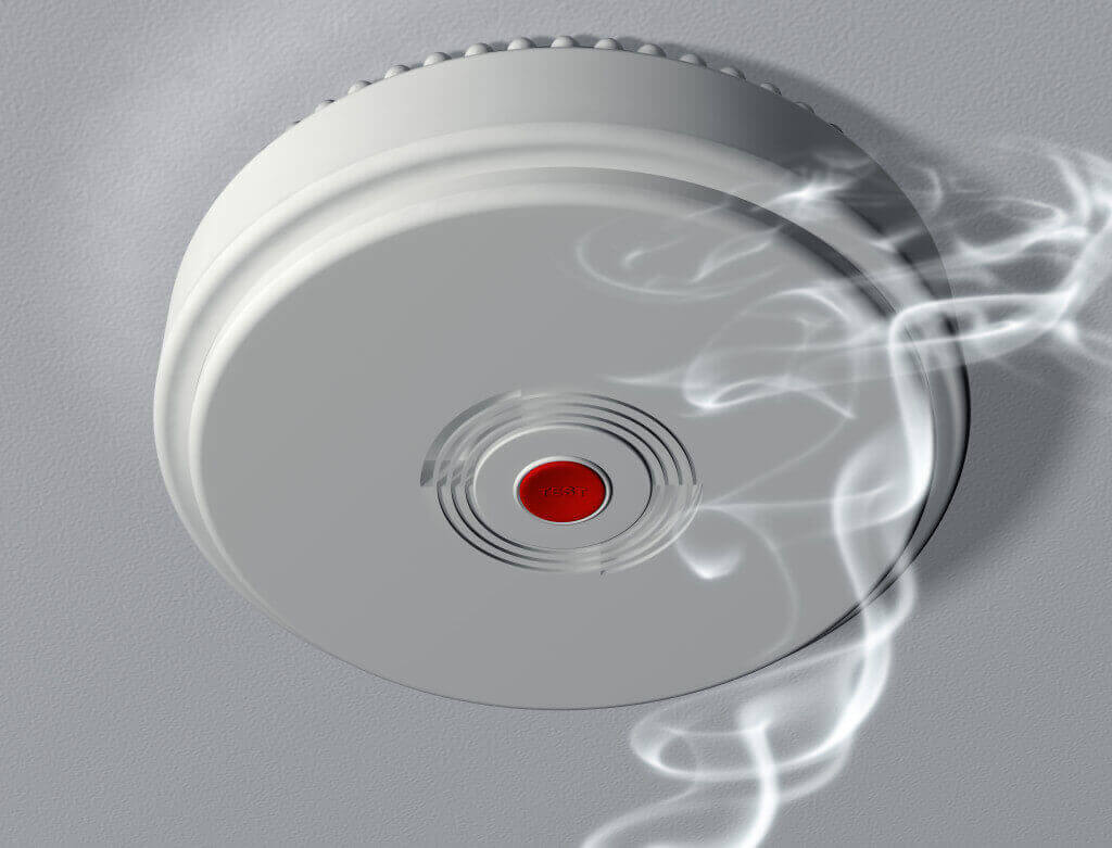 smoke alarms being installed in new home by RTL Trades licensed electrician in Coorparoo